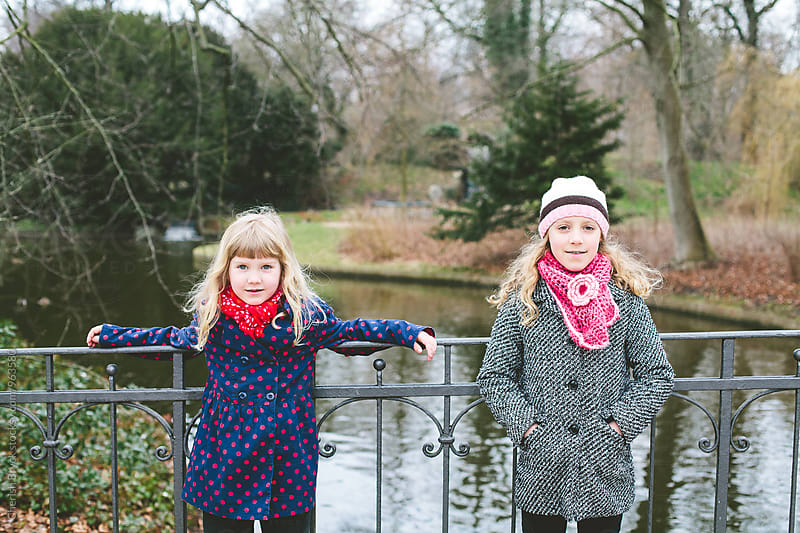 Sisters having fun. by Cherish Bryck for Stocksy United