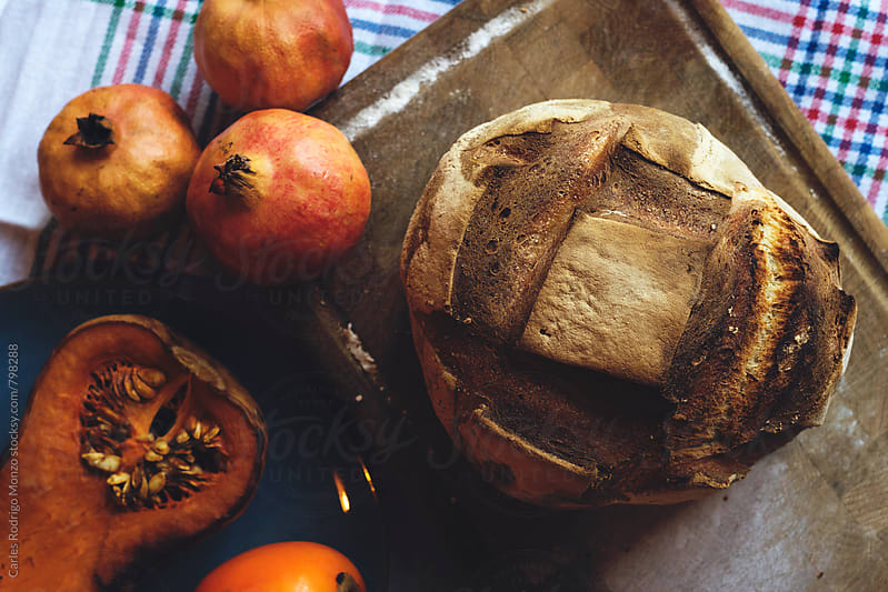 Bread and autumn fruits by Carles Rodrigo Monzo for Stocksy United