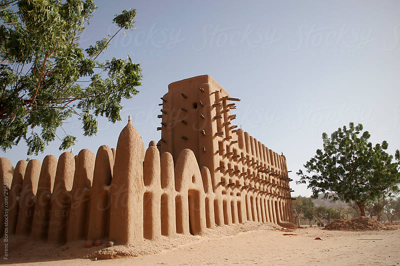 Adobe mosque from behind in Dogon country by Ferenc Boros for Stocksy United