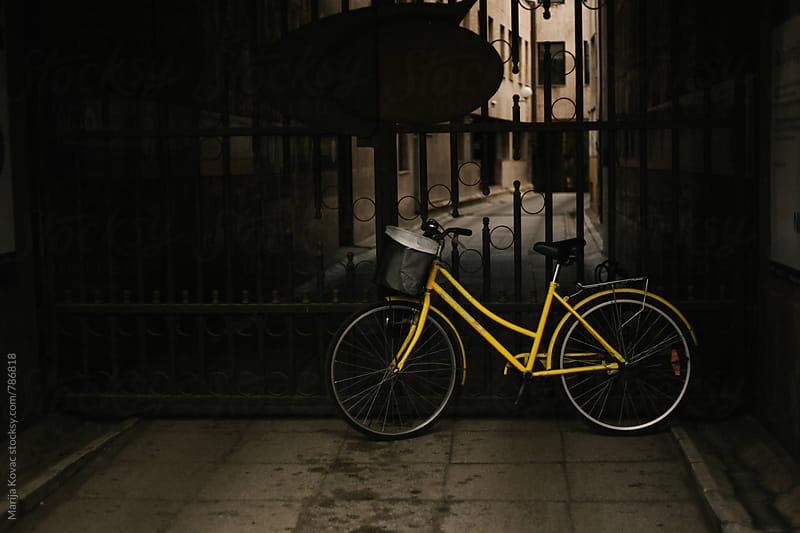 Yellow bicycle - horizontal by Marija Kovac for Stocksy United