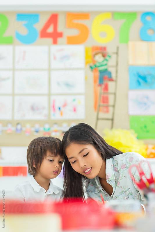 Kindergarten Teacher and Her Student by Lumina for Stocksy United