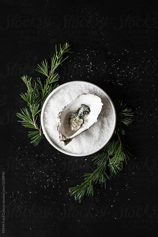 Oyster with marinated with sake, lime and pepper by KEMA Food Culture for Stocksy United