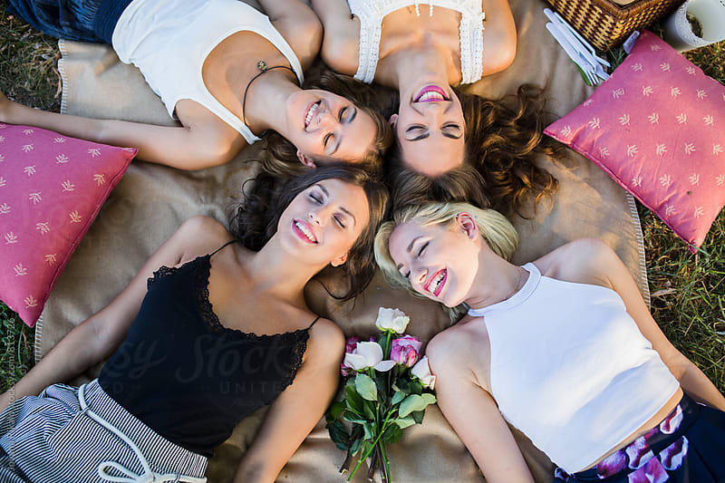Portrait of four happy female friends by Jovana Rikalo for Stocksy United