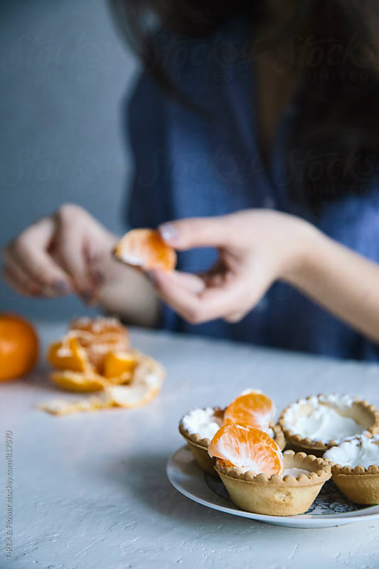 Close-up of four tarts with cheese cream and tangerine by Danil Nevsky for Stocksy United