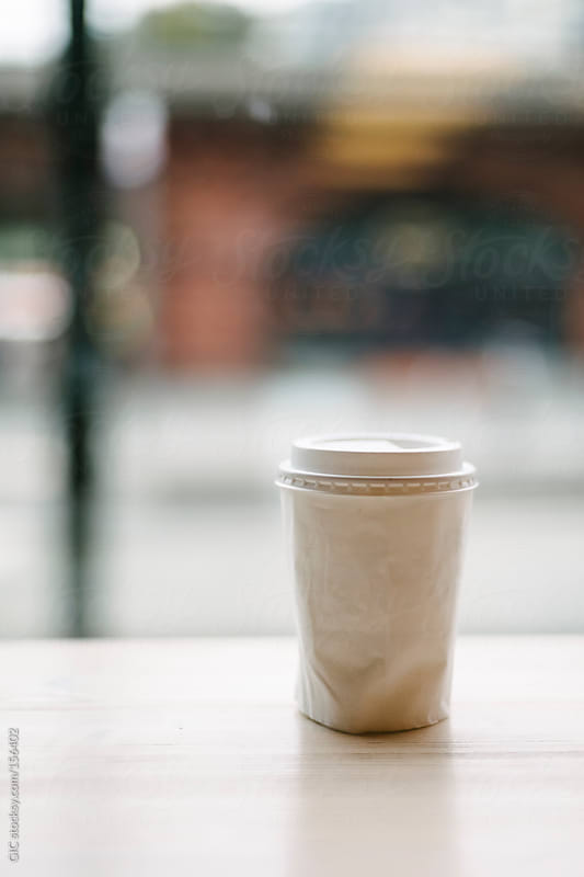 Cup of coffee on the table in a sidewalk cafe by GIC for Stocksy United