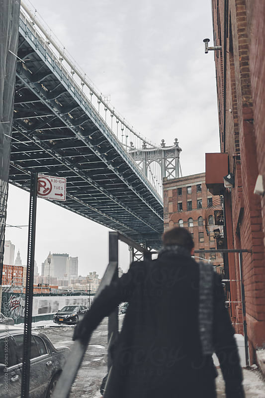 Young Man in Dumbo Brooklyn on a Winter Afternoon by Joselito Briones for Stocksy United
