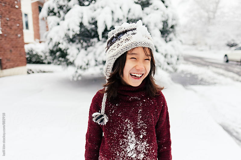 Cute Young Boy Laughing In Snow  by kelli kim for Stocksy United