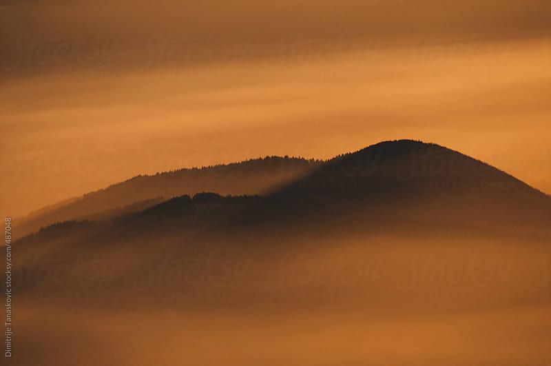 Mountains in the fog by Dimitrije Tanaskovic for Stocksy United