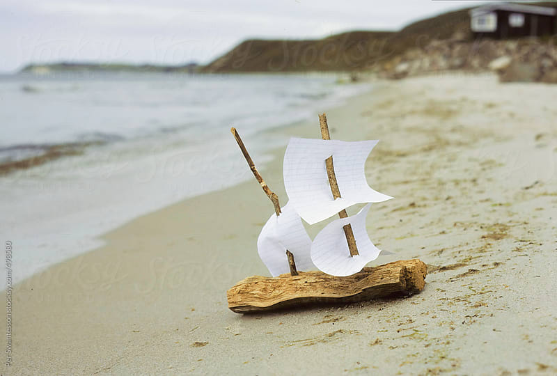 Miniature bark boat on beach by Per Swantesson for Stocksy United