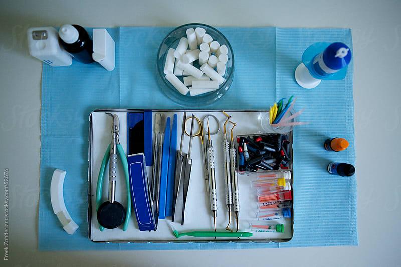 Dentist desk full of dental instruments by Freek Zonderland for Stocksy United