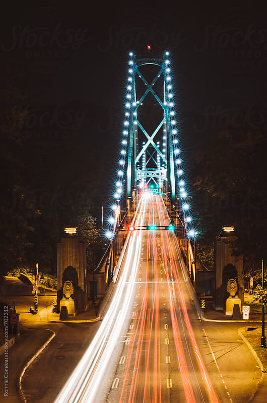 Light Trails From Cars On A Bridge by Ronnie Comeau for Stocksy United