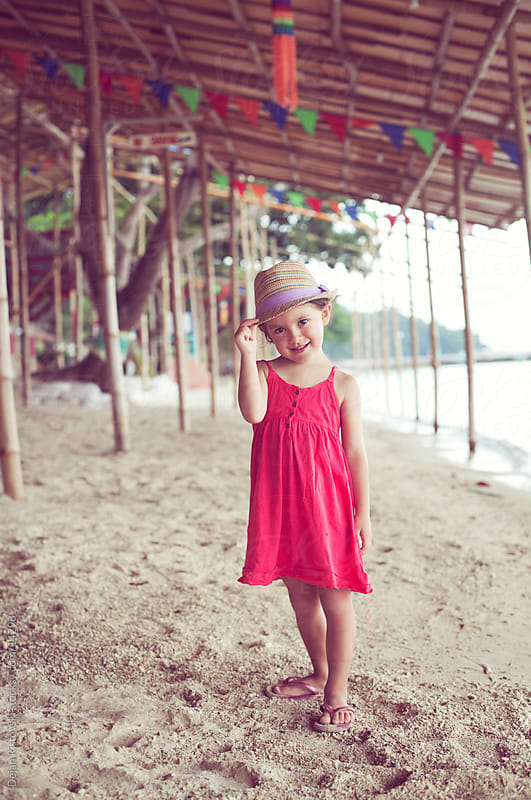 Little girl with red dress by Dejan Ristovski for Stocksy United