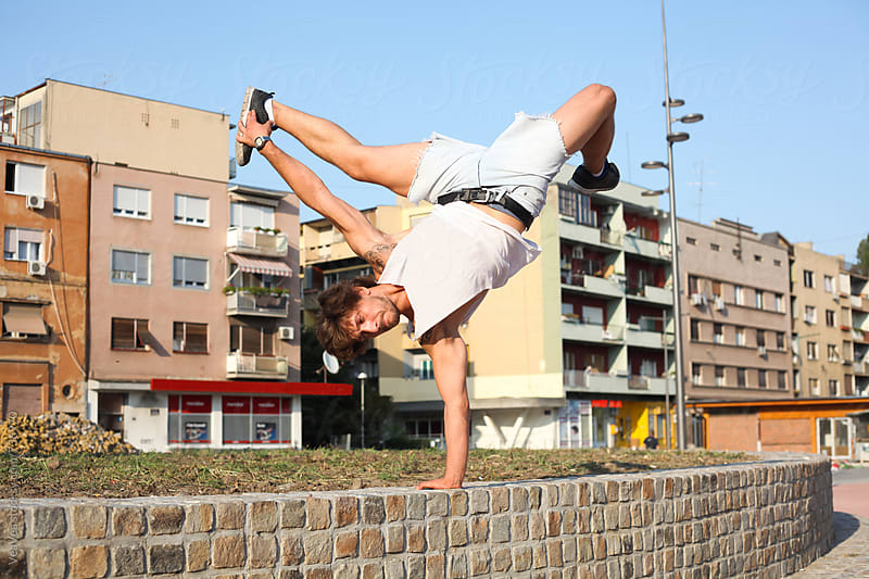 Man training in the city center  by VeaVea for Stocksy United