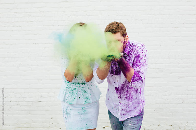 couple with colorful chalk mess by Brian Powell for Stocksy United