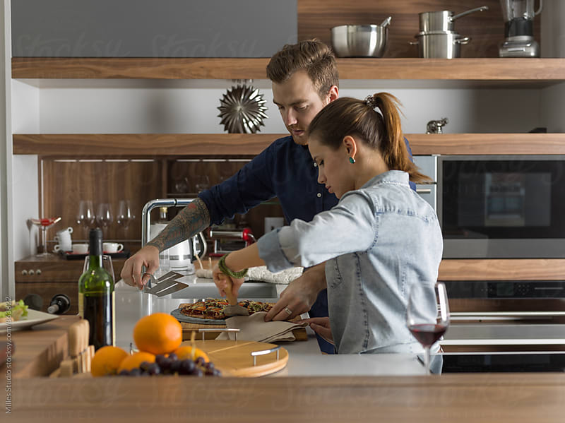 Loving couple cooking pizza by Milles Studio for Stocksy United