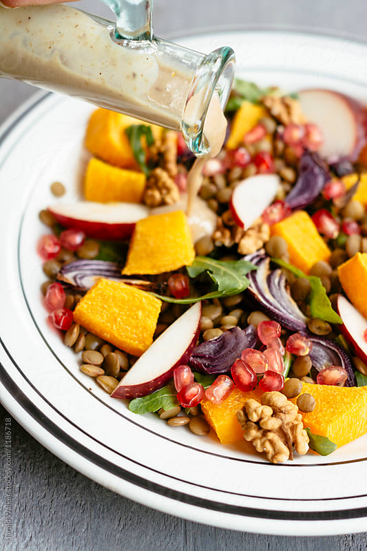 Warm Fall Salad with Walnut Maple Dressing by Harald Walker for Stocksy United