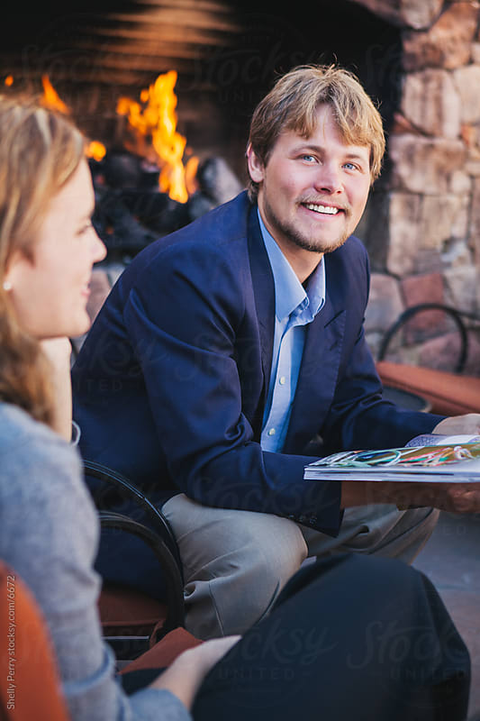 Young Man in an Outdoor Business Meeting by Shelly Perry for Stocksy United