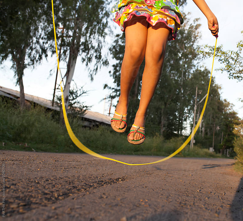 Closeup of a girl with jumping rope by PARTHA PAL for Stocksy United