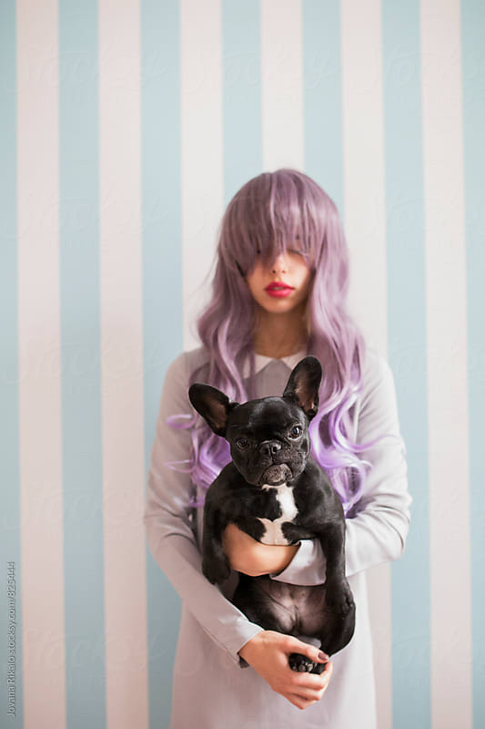 Fashionable young woman holding french bulldog by Jovana Rikalo for Stocksy United