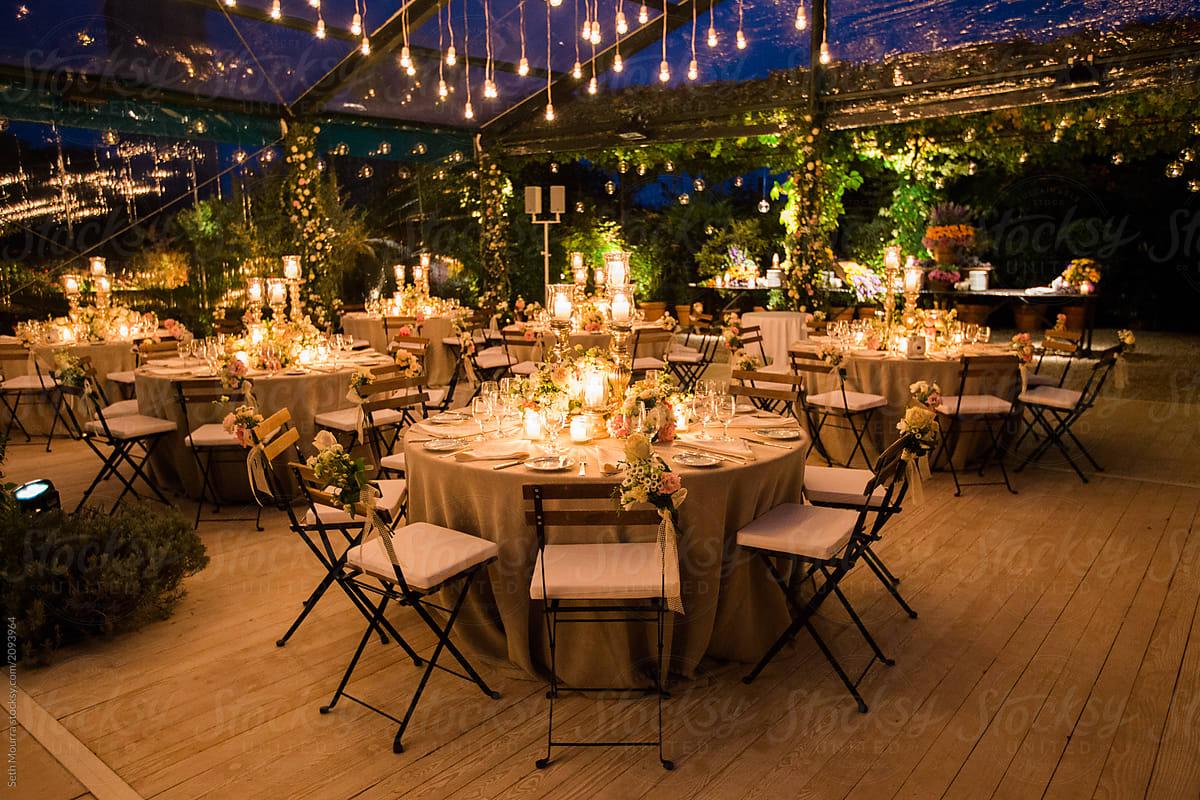 A candlelit elegant Italian wedding Reception in a clear marquee by Seth  Mourra - Candlelight, Wedding reception - Stocksy United