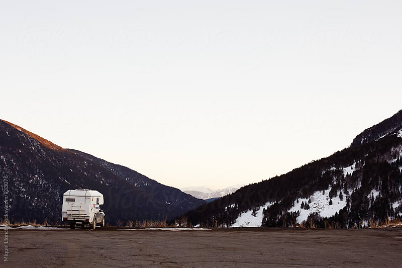 Scenic view of parked van in a mountain landscape by Miquel Llonch for Stocksy United