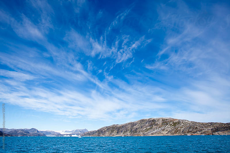 Boat travel near Nagtivit glacier, Greenland by Alex Hibbert for Stocksy United