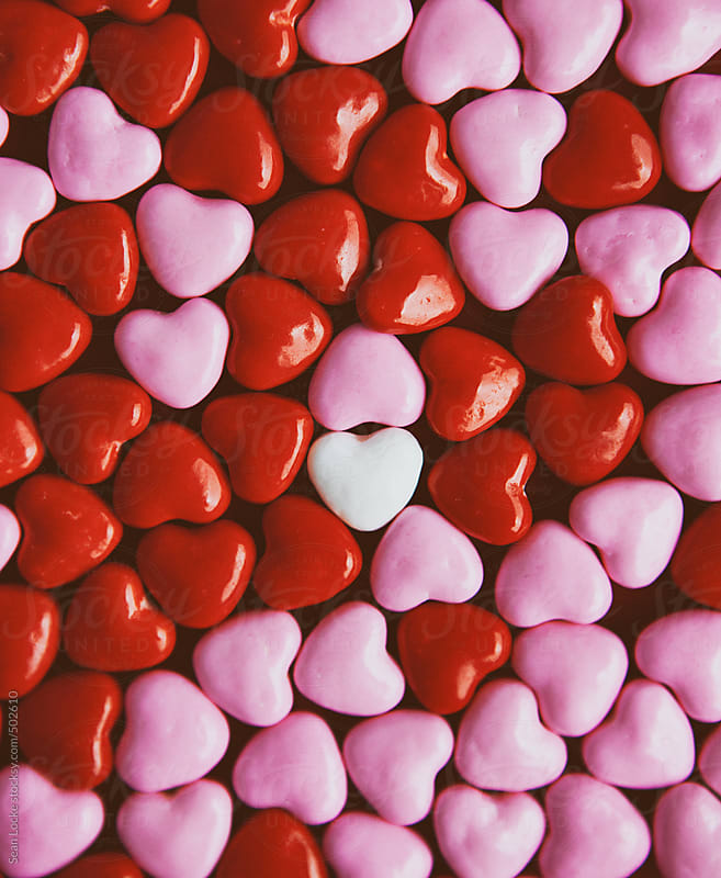 Valentine's: White Heart Candy Stands Out From Crowd by Sean Locke for Stocksy United