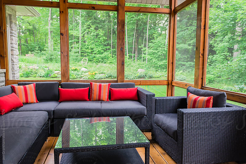 Muskoka room with modern sectional furniture by Jen Grantham for Stocksy United
