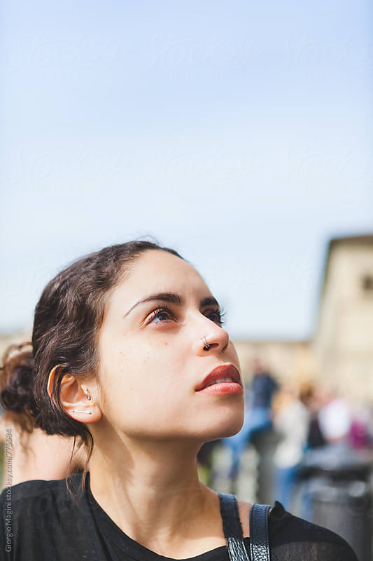 Portrait of Young Woman Looking Up to the Sky by Giorgio Magini for Stocksy United