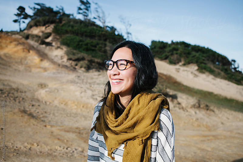 Happy, hip vietnamese woman smiling outdoors by Kristine Weilert for Stocksy United
