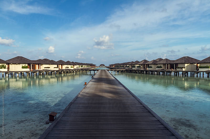 Watervilla on the maledives by Leander Nardin for Stocksy United