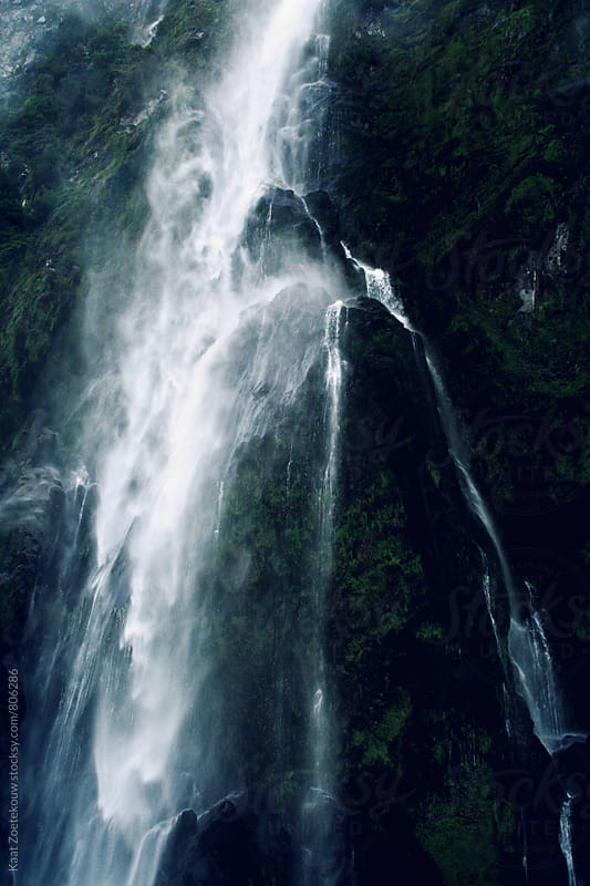 Moody, gushing waterfall in New Zealand's fjord (sound) region. by Kaat Zoetekouw for Stocksy United