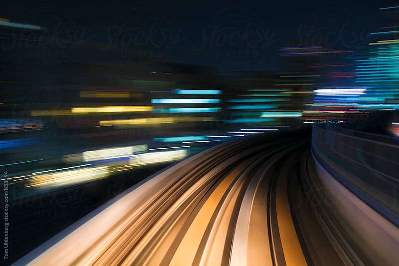 Speed and Motion - Riding on a Train through a Megacity at Night by Tom Uhlenberg for Stocksy United