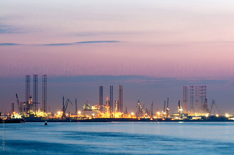 Industrie in the Port of Rotterdam, at sunset. by Jan Bijl for Stocksy United