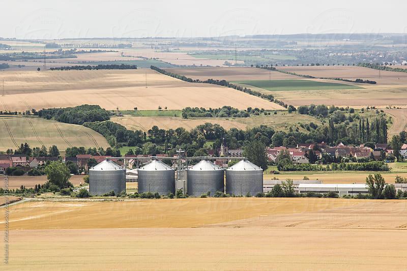 Silo in a rural summer landscape by Melanie Kintz for Stocksy United