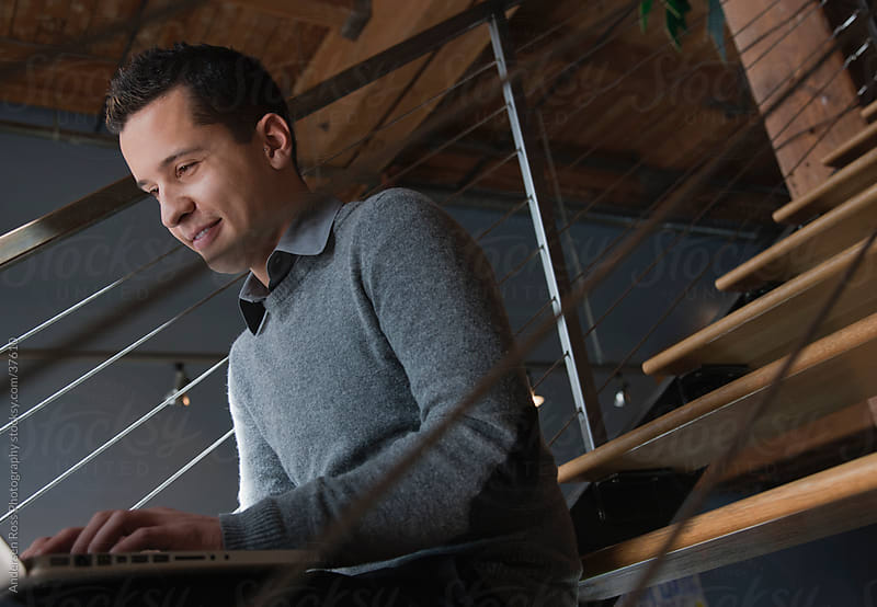 Business man sitting on steps and using laptop by Andersen Ross Photography for Stocksy United