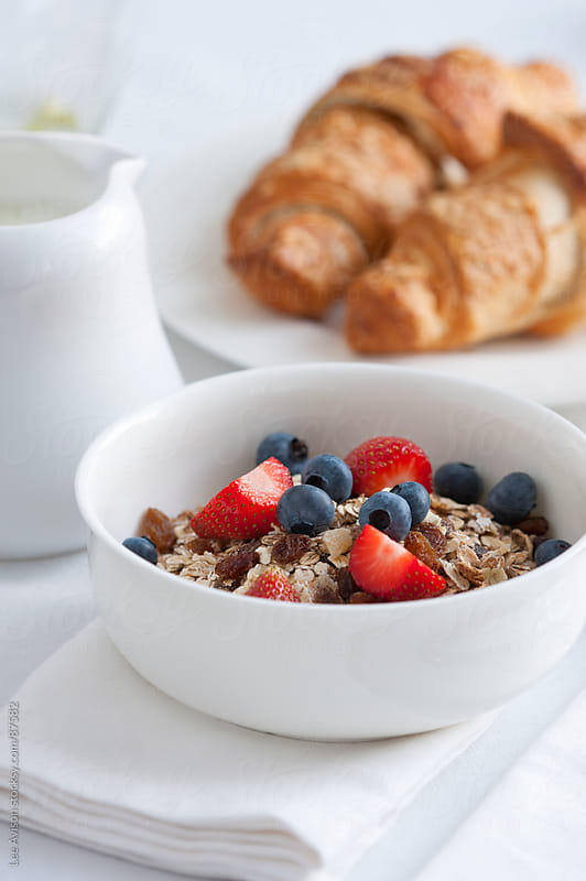 muesli and croissant breakfast by Lee Avison for Stocksy United