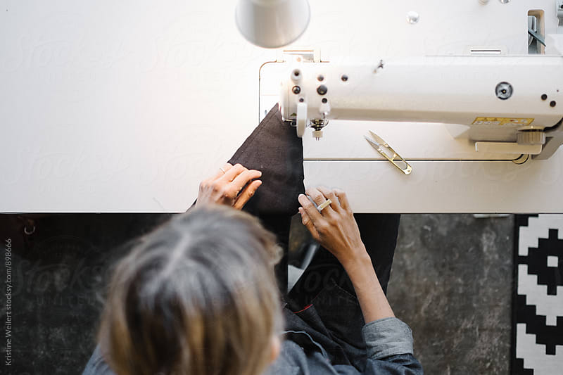 Woman Using Sewing Machine by Kristine Weilert for Stocksy United