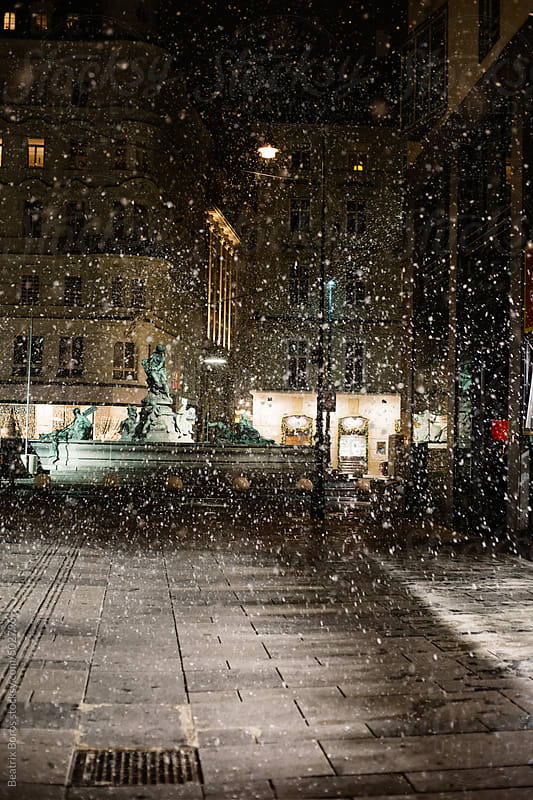 Snowflakes in one of Vienna's squares by Beatrix Boros for Stocksy United