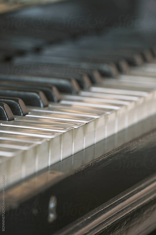 Closeup of old piano keys. by BONNINSTUDIO for Stocksy United