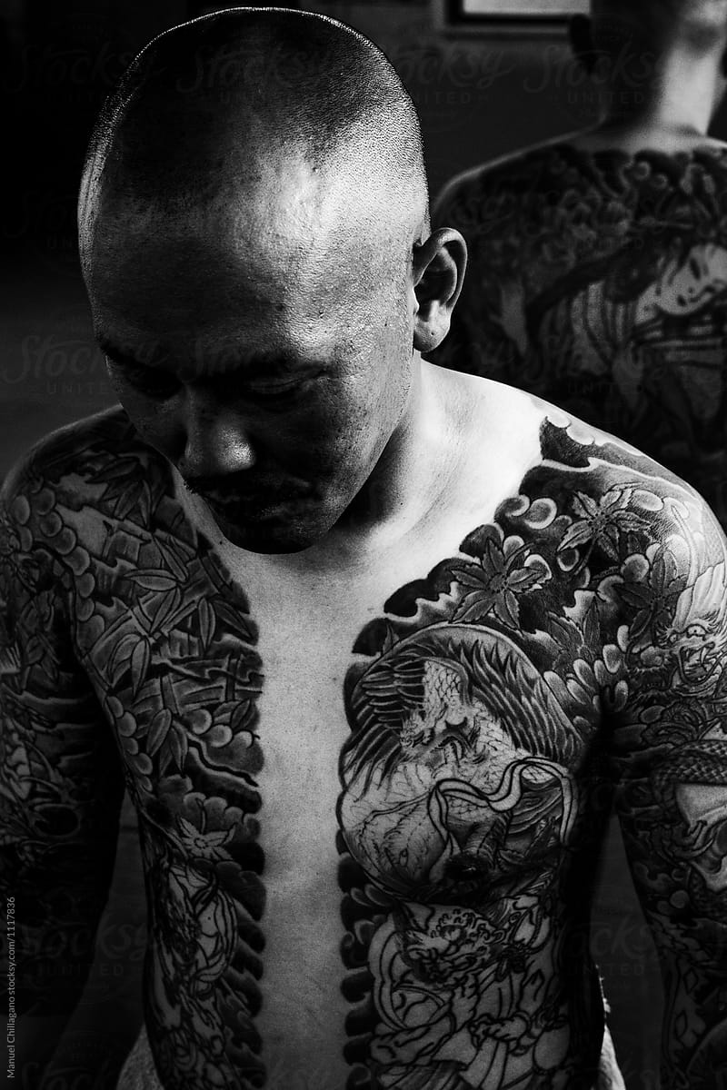 Black And White Portrait Of A Japanese Man With Traditional Tattoos