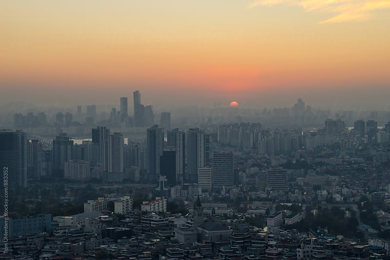 Sunset over Seoul Skyline, South Korea by Tom Uhlenberg for Stocksy United