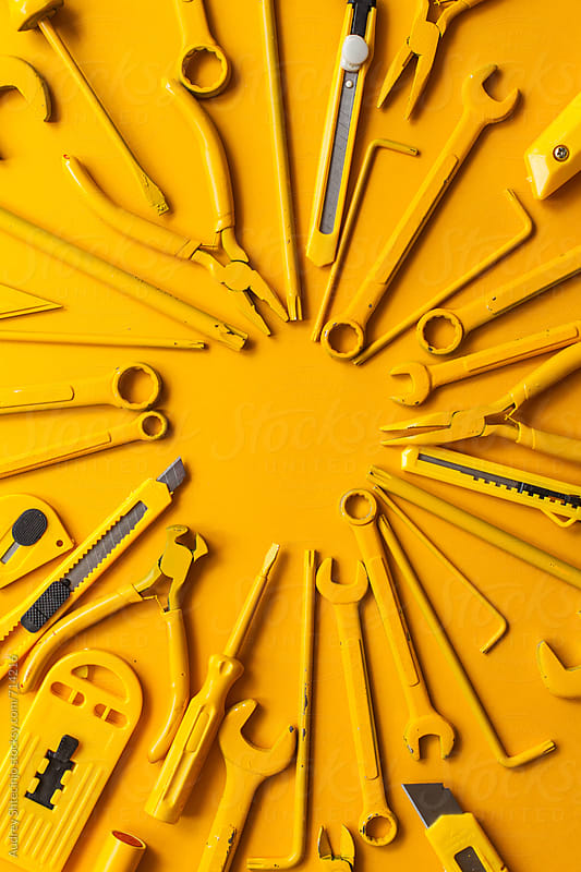 yellow work tools of a craftsman arranged.  by Marko Milanovic for Stocksy United