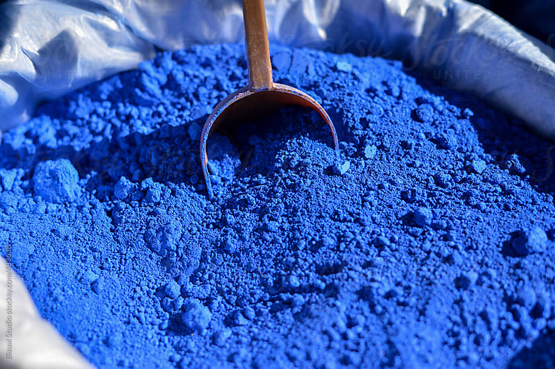 Coloured powdered of blue pigment by Bisual Studio for Stocksy United