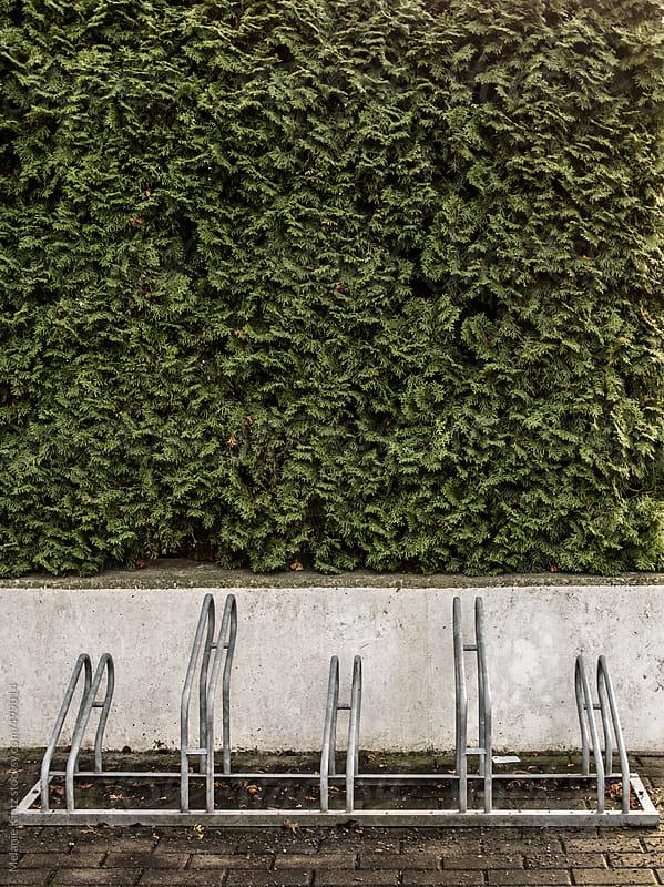Empty bike rack outside a house by Melanie Kintz for Stocksy United