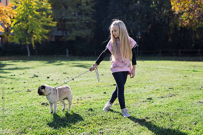 Young girl outdoor with her dog by Mauro Grigollo for Stocksy United
