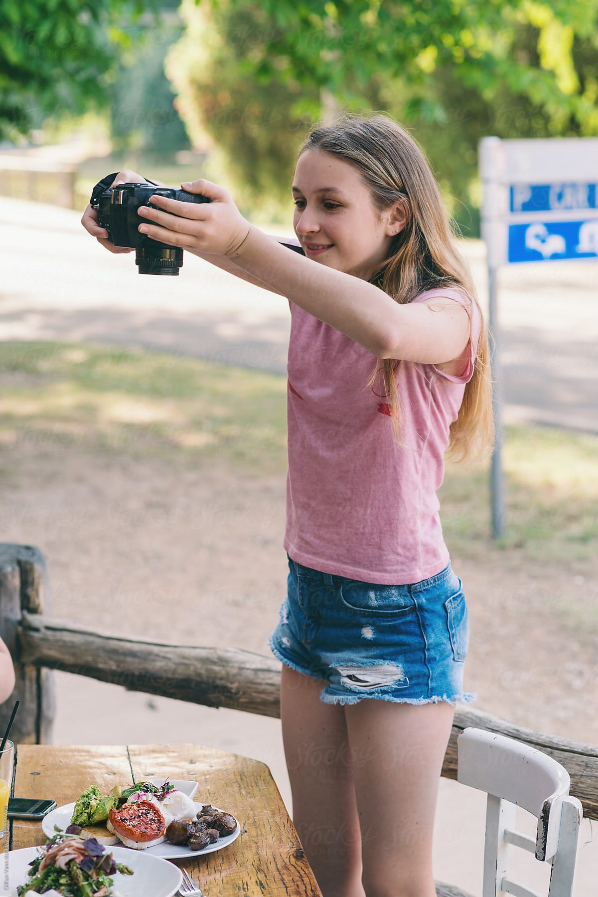 c2025d260e75 Teen Taking Photos Of Her Food With DSLR