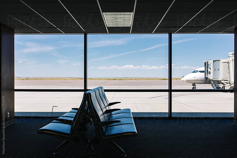 Airport seats with airplane ready to travel from terminal by Matthew Spaulding for Stocksy United