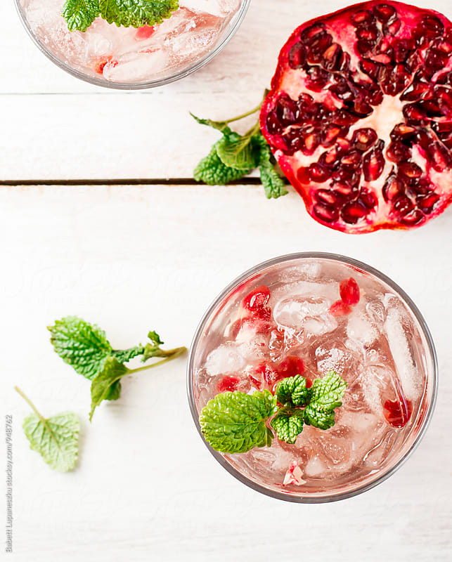 Cocktail drink with pomegranate by Babett Lupaneszku for Stocksy United
