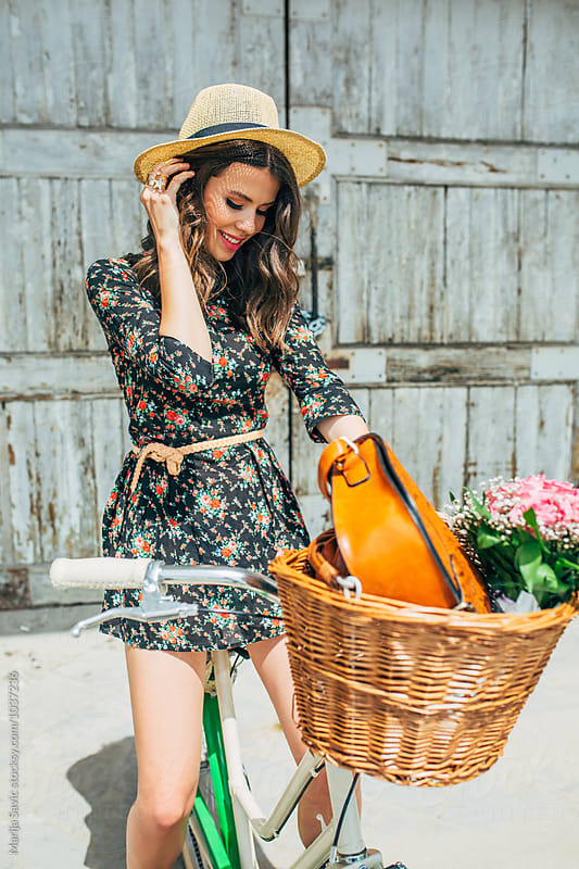 Woman on Bicycle by Marija Savic for Stocksy United